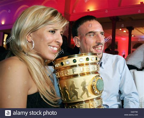 Franck Ribery and his wife Wahiba Ribery pose with the DFB
